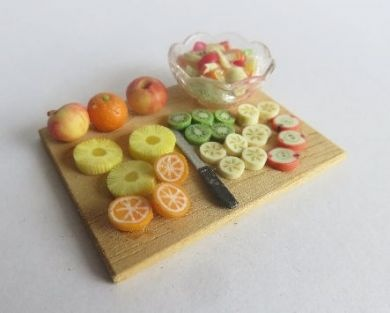 Fruit salad preparation board with bowl